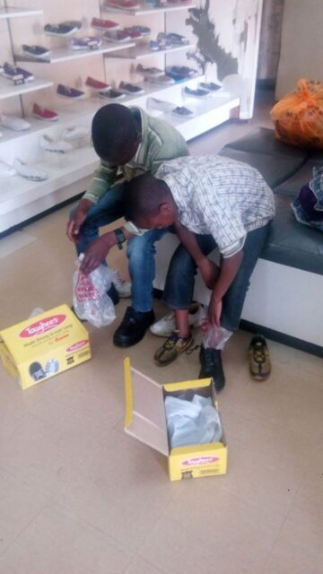 the-boys-trying-on-the-school-shoes