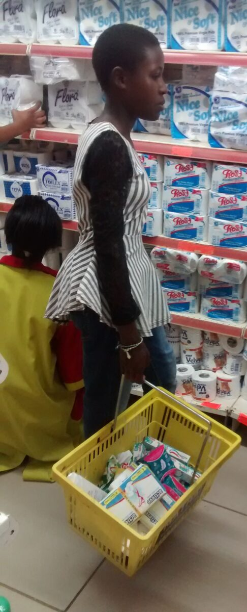 Esther carrying the shopping basket