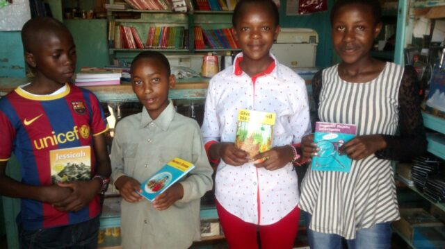 The kids holding the story books