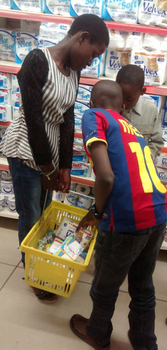The kids putting some items in the basket