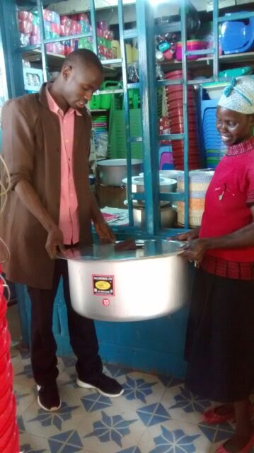 Josephine buying a bigger pot for cooking