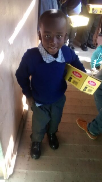 Gift looking all smart in his new school uniform