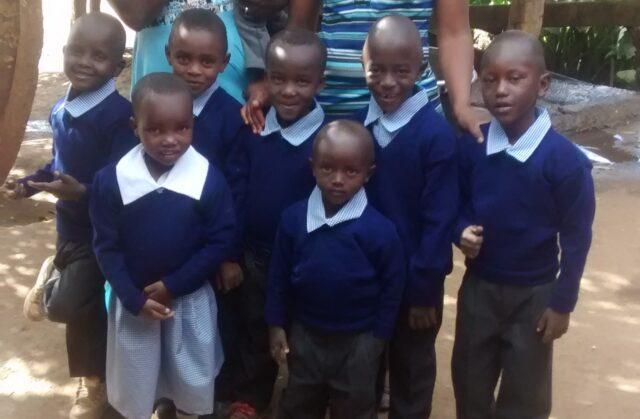 kindergarten kids in their new school uniform