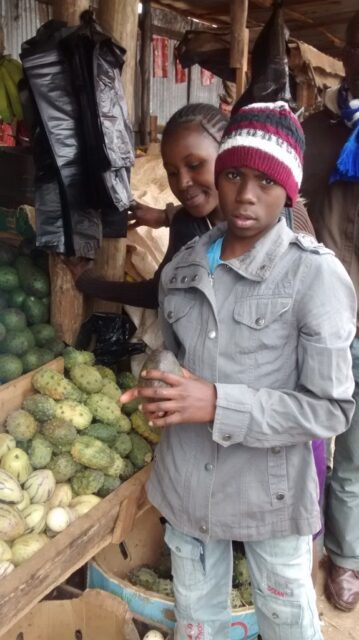 The karatina kids choosing fruits at the market