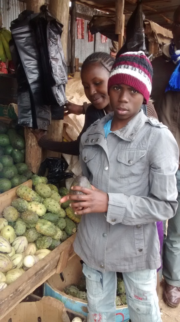 The karatina kids choosing fruits at the market
