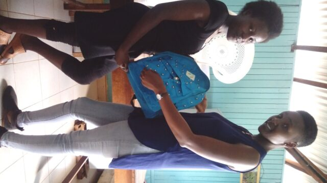 Esther receiving her gift
