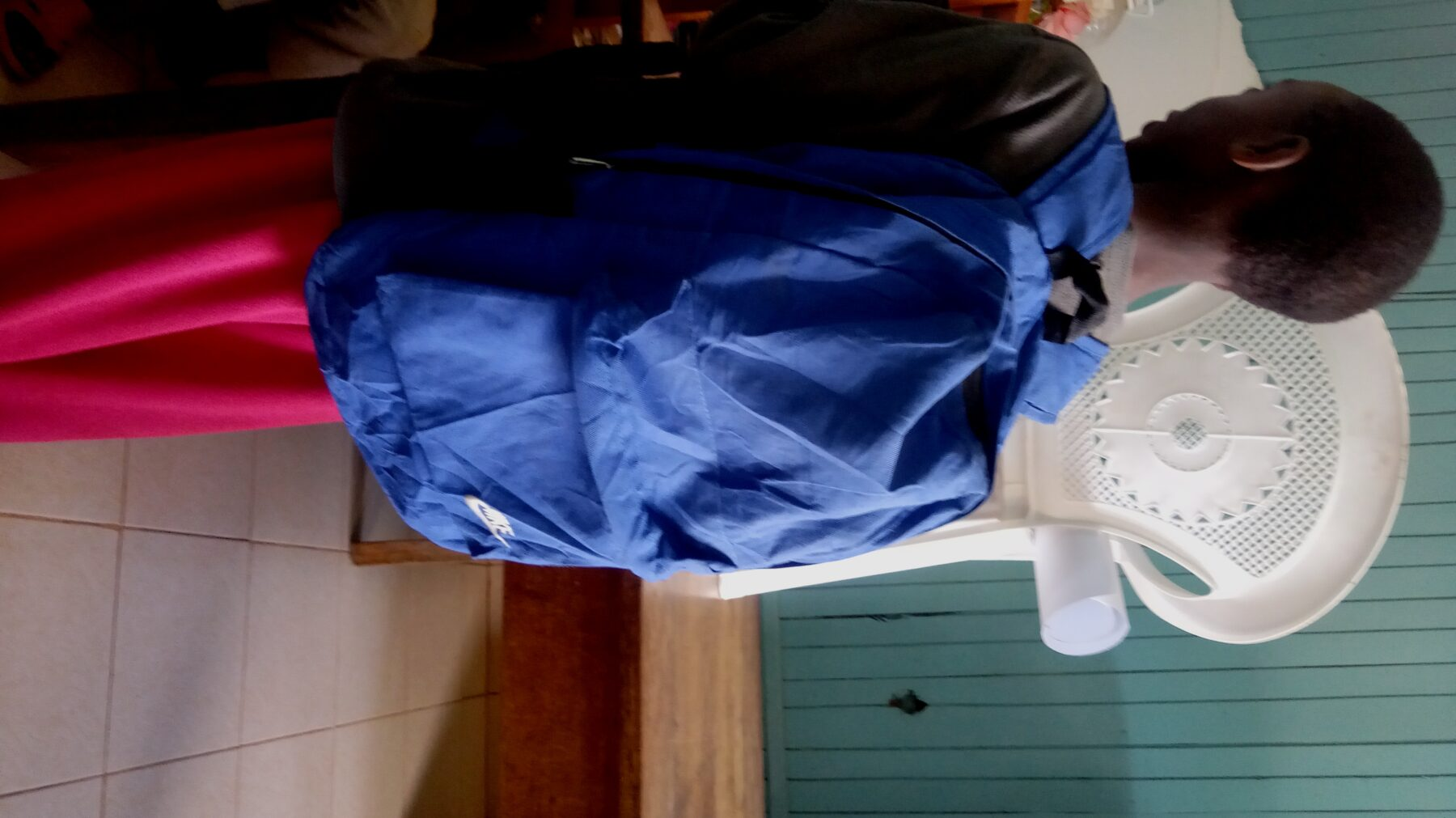 Kang'ara carrying his bag