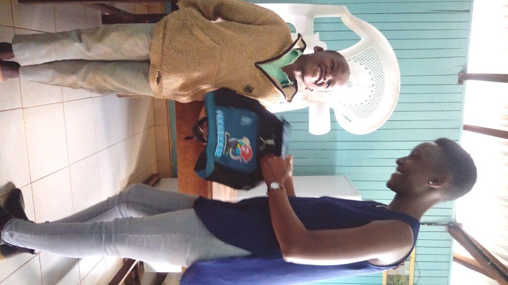 Njiraini receiving his gift