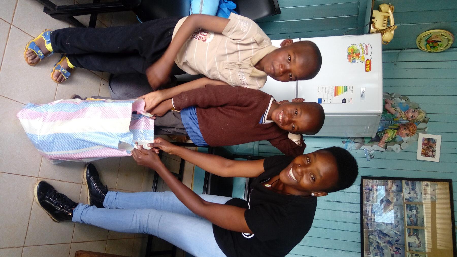 The karatina kids receiving their shopping