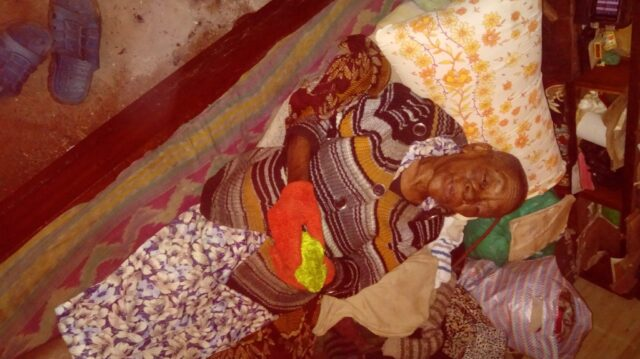 Mary Wairimu sleeping on her new pillow and wearing her new gloves