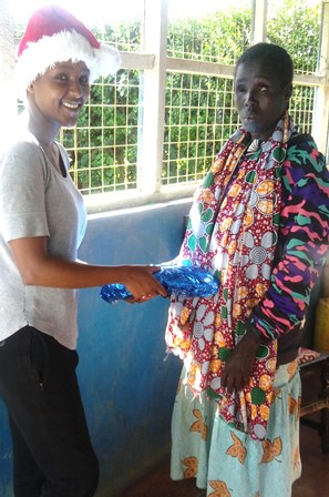 Esther Nanyiro receiving her gift from shiro