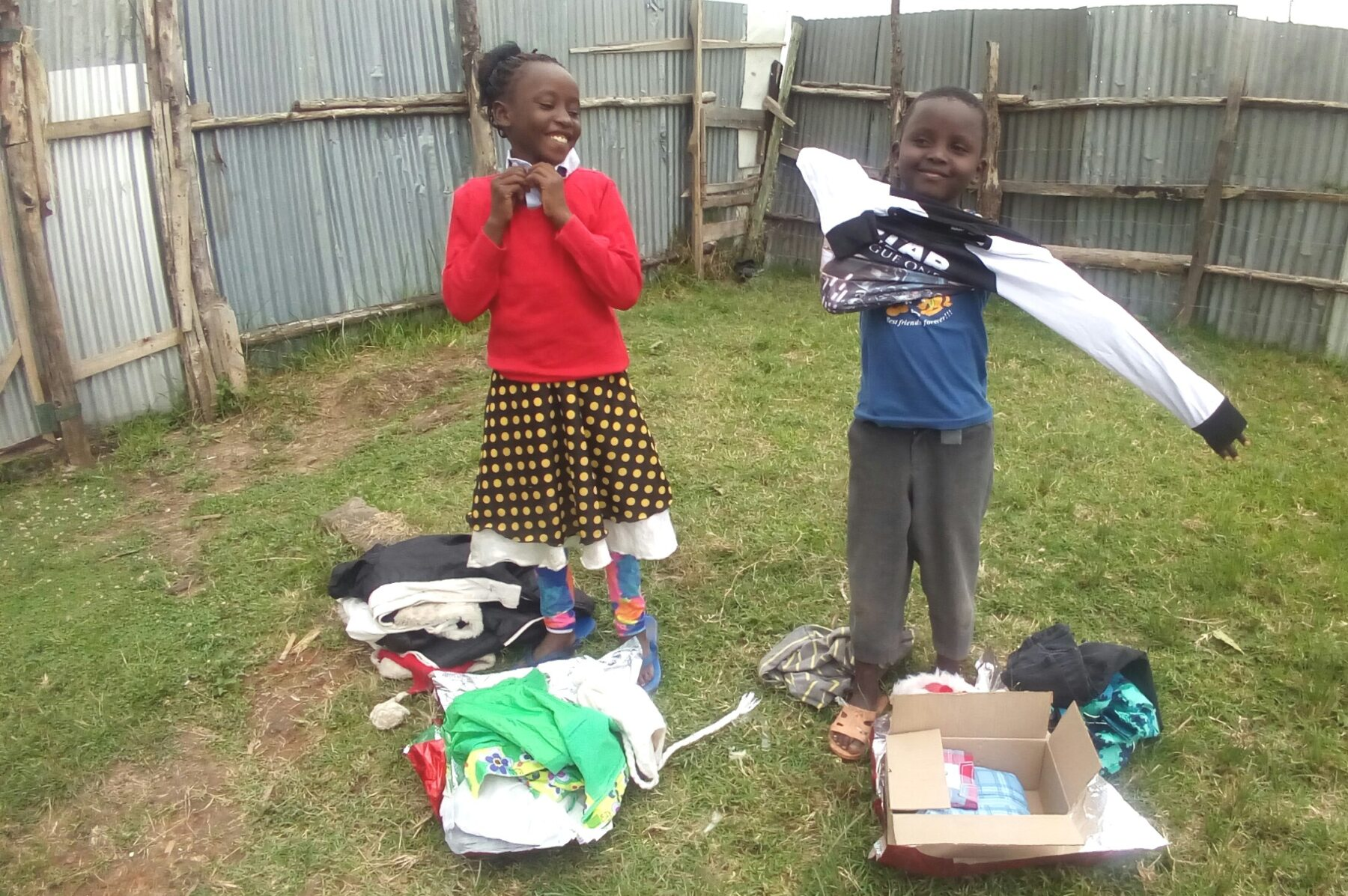 Happy kids trying out their new clothes
