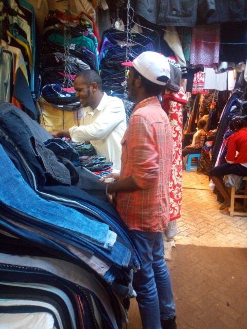 Kevin at the market shopping for a jeans