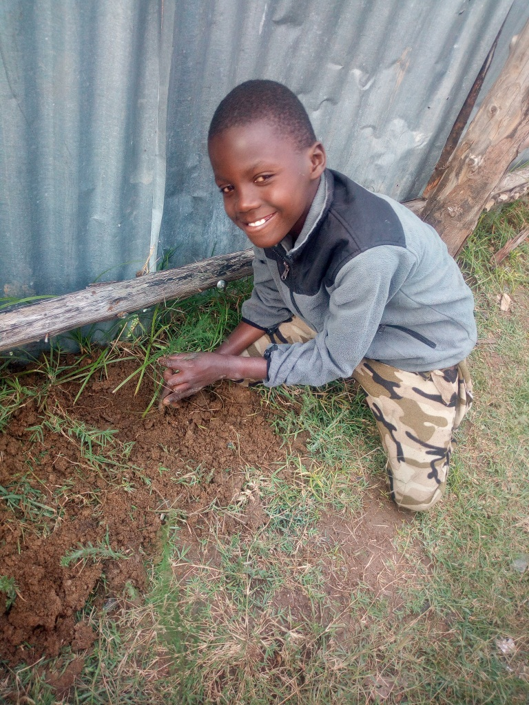 Kinoti happy after planting his first tree