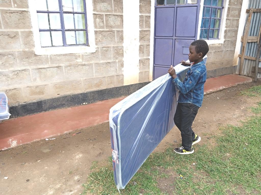Mark carrying a mattress