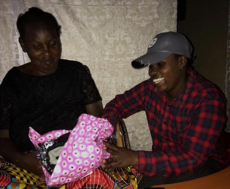 Wandia opening her gift