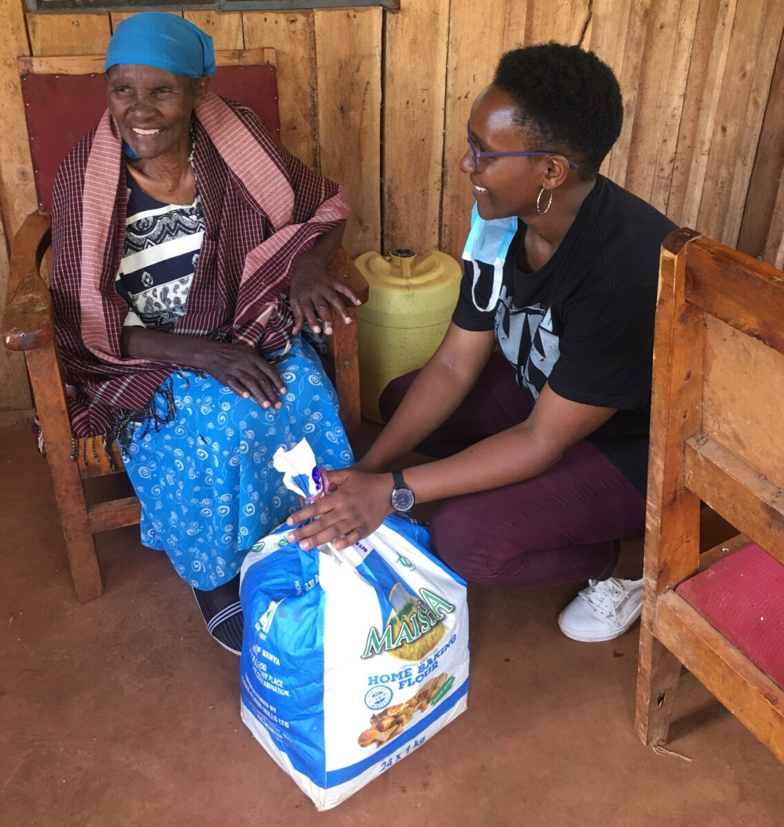 Wanja receiving her food package from shiro