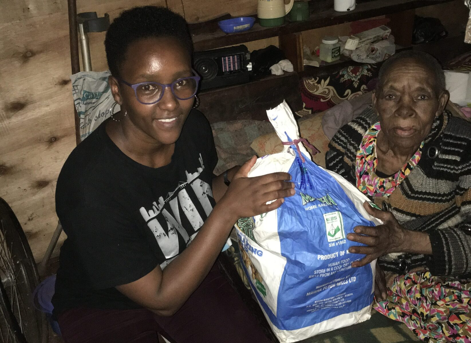 Mary Wairimu receiving her monthly food package
